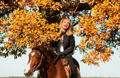 Beautiful woman walking with horse Royalty Free Stock Photo