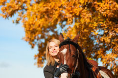 Beautiful woman walking with horse Royalty Free Stock Image