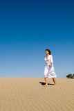 Beautiful Woman Walking In The Sand Royalty Free Stock Image