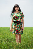 Beautiful woman walking on the meadow Royalty Free Stock Photos
