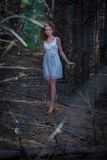 Beautiful woman walking in mystery forest Stock Photo