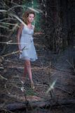 Beautiful woman walking in mystery forest Royalty Free Stock Photo