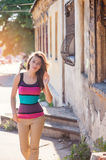 Beautiful woman walking near the old buildings in the city Stock Images