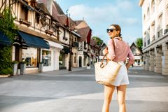 Woman traveling in Deauville city, France royalty free stock photography
