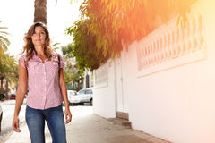 Beautiful woman walking outdoors in the sunlight Royalty Free Stock Image