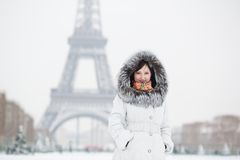 Beautiful woman walking in Paris on a winter day Royalty Free Stock Photos