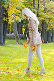 Beautiful woman walking in park Royalty Free Stock Photos