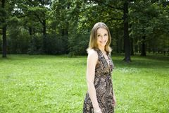 Beautiful Woman Walking On The Park Royalty Free Stock Photography