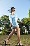 Beautiful Woman Walking In The Park Royalty Free Stock Photo