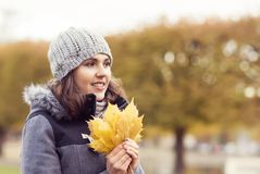 Beautiful woman walking in park. Girl over seasonal autumn background. royalty free stock photos