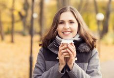 Beautiful woman walking in park. Girl over seasonal autumn background. royalty free stock images