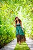 A beautiful woman walking through the resort Stock Photos