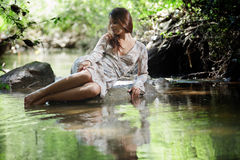 Beautiful woman walking in river Stock Photo