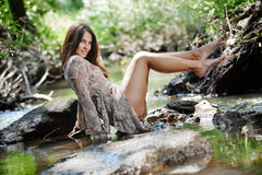 Beautiful woman walking in river Stock Photography