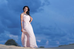 Beautiful woman walking on a sand dune Royalty Free Stock Images
