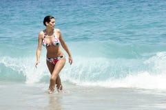 Beautiful woman walking on the sea Royalty Free Stock Photos