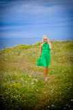 Beautiful woman walking by sea Royalty Free Stock Image