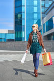 Beautiful woman walking with shopping bags Stock Image