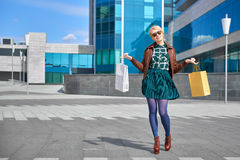 Beautiful woman walking with shopping bags Stock Photos