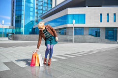 Beautiful woman walking with shopping bags Royalty Free Stock Image