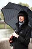 Beautiful woman walking on street with umbrella stock photo