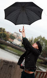 Beautiful woman walking on street with umbrella Stock Images