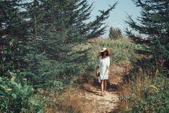 Beautiful woman walking on summer nature Stock Photos