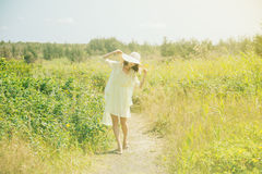 Beautiful woman walking in the summer park Royalty Free Stock Image