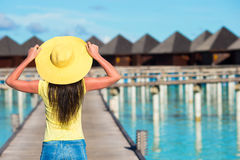 Beautiful woman walking to water bungalow at Royalty Free Stock Photography