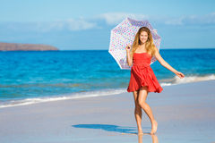 Beautiful Woman Walking on Tropical Beach Royalty Free Stock Images
