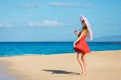 Beautiful Woman Walking on Tropical Beach Stock Images
