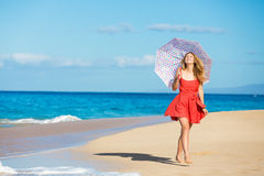 Beautiful Woman Walking on Tropical Beach Stock Photography