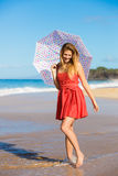 Beautiful Woman Walking on Tropical Beach Stock Photos