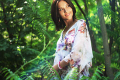 Beautiful woman walking in tropical forest Royalty Free Stock Image