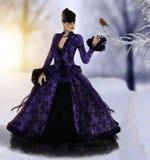 Beautiful woman walking in winter watches bird Stock Images