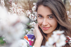Beautiful woman walks in the blossoming spring garden Royalty Free Stock Images