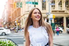 A beautiful woman walks on city street to the office at the morning and enjoy her day. royalty free stock images