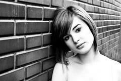 Beautiful woman on wall Stock Photo