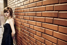 Beautiful woman on wall Royalty Free Stock Photos