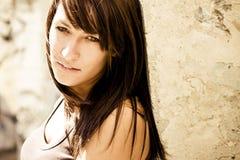 Beautiful woman on wall Stock Photography