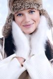 Beautiful woman in warm clothing closeup portrait Stock Photography