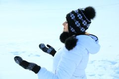 Beautiful woman in warm clothing with snow Stock Photos