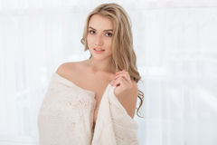 Beautiful woman in warm knitted handmade clothes at home. Royalty Free Stock Images