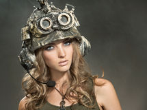Beautiful woman warrior in a helmet. Portrait of a beautiful woman warrior in a helmet Stock Image