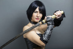 Beautiful woman-warrior with sword Royalty Free Stock Photography