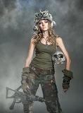 Beautiful woman warrior. With a weapon and skull Royalty Free Stock Images