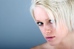 Beautiful woman with a wary look Stock Photography
