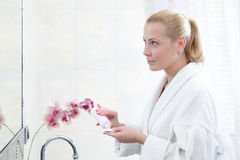 Beautiful woman washes face Royalty Free Stock Images
