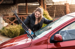 Beautiful woman washing car windscreen Stock Photos