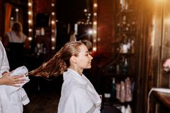Beautiful woman washing hair in a hair salon stock images